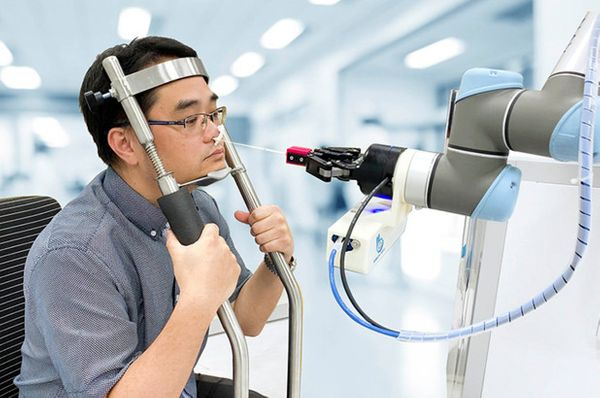 Nose-swabbing COVID-19 robot offers terrifying vision of the future